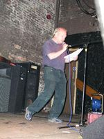 Trev performing at Writers Cafe 2006